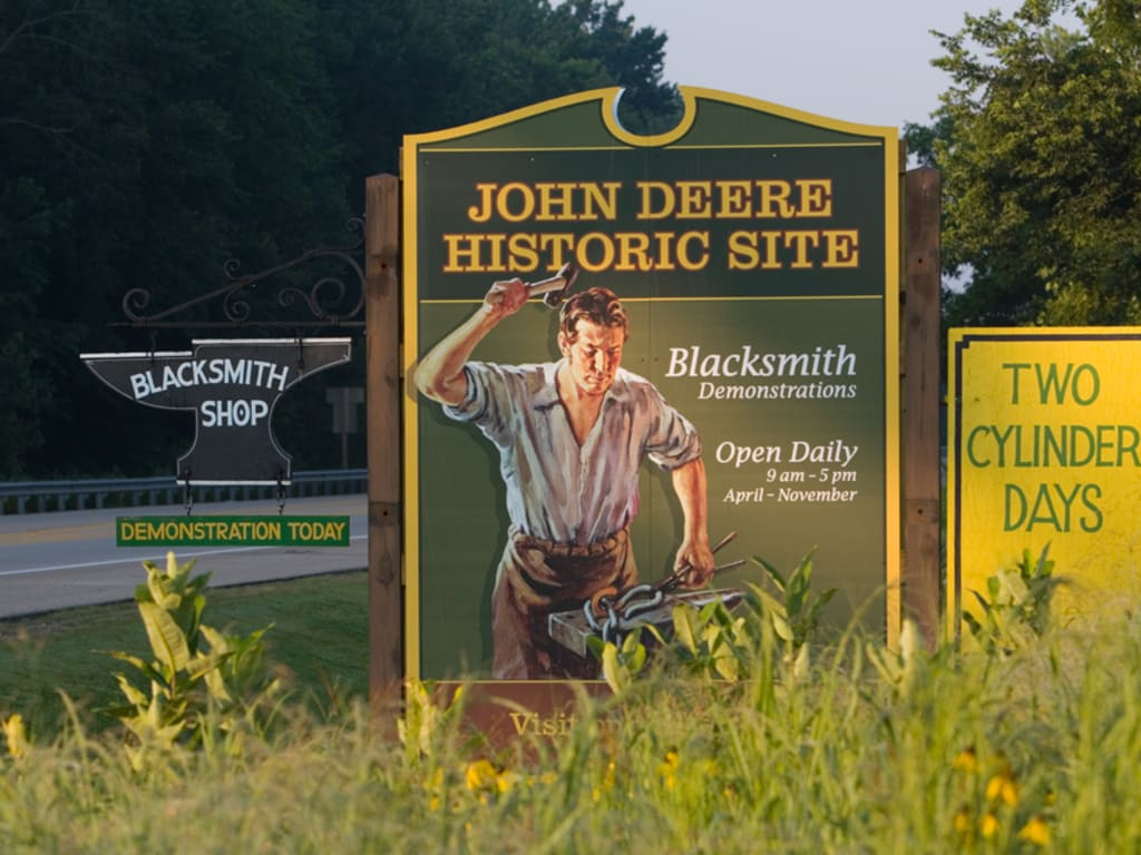 The John Deere Historic Site welcome sign is displayed