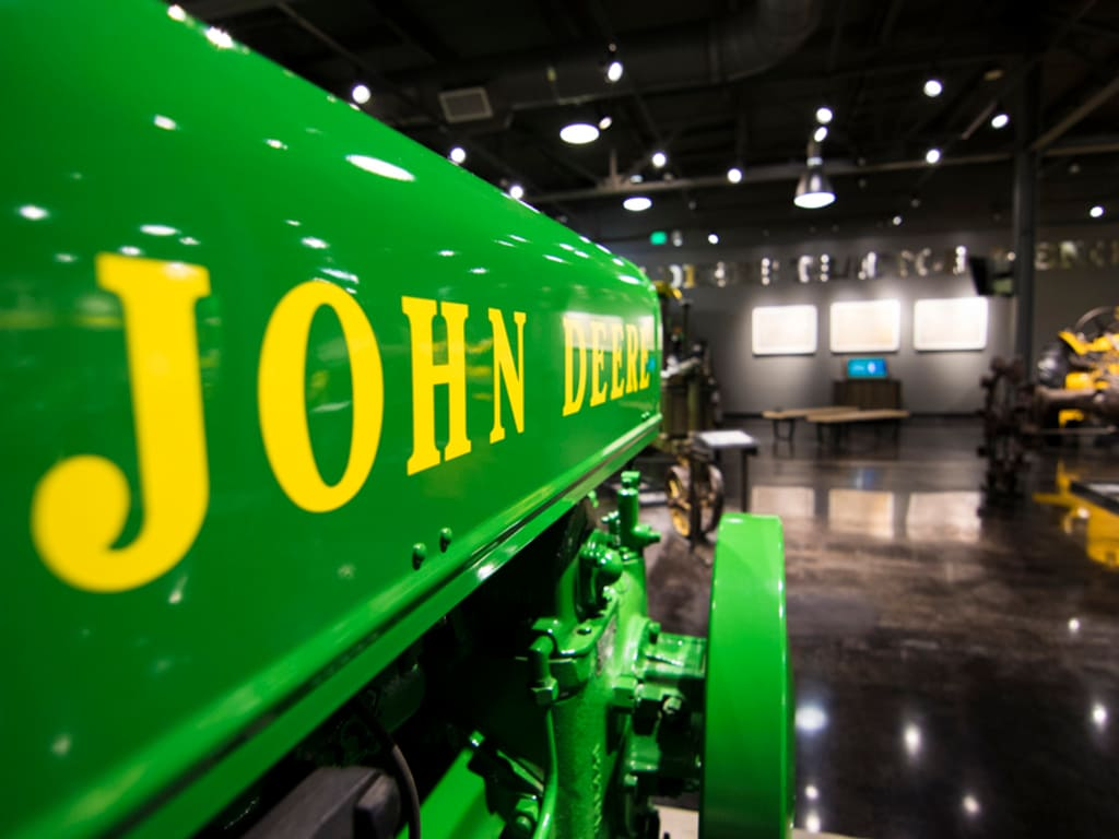 Close up of the front end of a vintage John Deere tractor