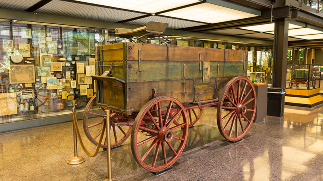 A vintage wagon sits on the display floor