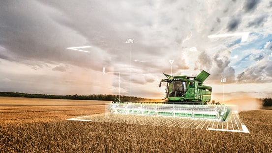 Combine in a field with holographic overlay of harvesting grid with software icons.