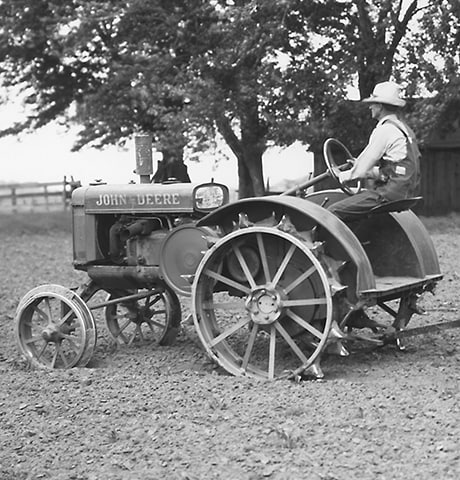 "Historical John Deere ""GP"" General Purpose Tractor pulling a John Deere No. 7 Rotary Hoe in field"